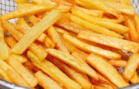 caloric: Heap of french fries fried in oil, deep fried, unhealthy and caloric food