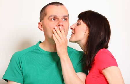 unexpected: Shocked man receive an unexpected message from woman, hands covering mouth, face expression and human emotion