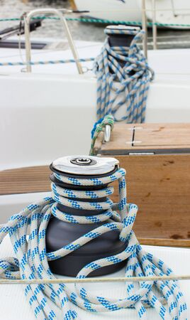 coiled: Yachting, coiled rope and bollard on sailboat, details and part of yacht Stock Photo