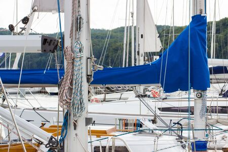 coiled: Yachting, parts of sailboat in port of sailing, coiled rope, sail, details of yacht Stock Photo