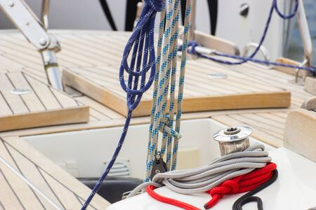 yacht: Yachting, colorful rope and bollard on deck of sailboat, details and part of yacht Stock Photo