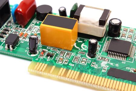 printed circuit: Printed circuit board with electrical components lying on white background