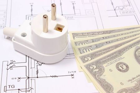 energy work: Electric plug and money on electrical construction drawing of house, accessories for engineering work, concept for energy saving