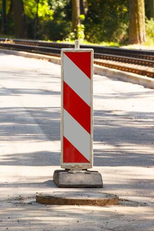 informing: Road sign informing about danger during pavement repair, road construction on city street