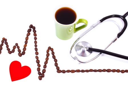 ecg heart: Electrocardiogram line of roasted coffee grains, cup of coffee and medical stethoscope on white background, ecg heart rhythm, medicine and healthcare concept