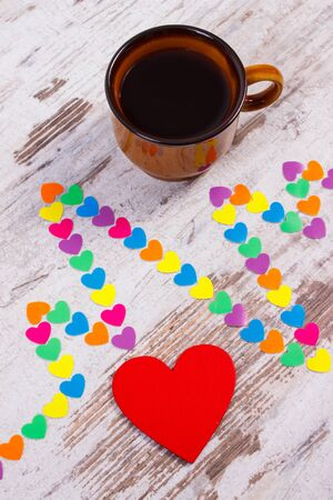 ecg heart: Electrocardiogram line of colorful paper hearts and cup of coffee on old wooden rustic background, ecg heart rhythm, medicine and healthcare concept