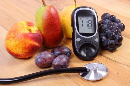 Zuckermessgerät mit Stethoskop und medizinische frischen Früchten, Konzept von Diabetes, eine gesunde Lebensweise und Ernährung Standard-Bild - 45527482