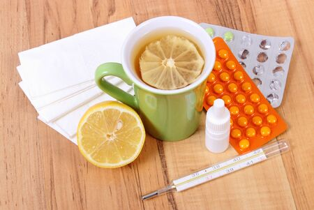 handkerchiefs: Pills and nose drops for colds, handkerchiefs and hot tea with lemon, treatment of colds, flu and runny Stock Photo