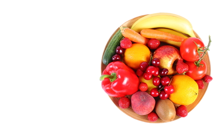 inmunidad: Fresh ripe fruits and vegetables lying on wooden plate, copy space for text, concept of healthy food, nutrition and strengthening immunity. Isolated on white background