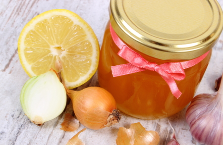 honey jar: Fresh organic honey in glass jar, onion, garlic and lemon on old wooden background, healthy nutrition, strengthening immunity and treatment of flu