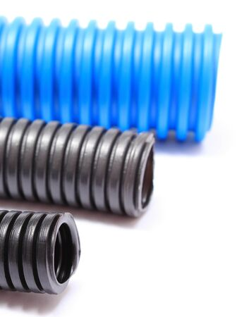 plastic conduit: Corrugated plastic pipe for electrical cable, component for use in installations. Isolated on white background