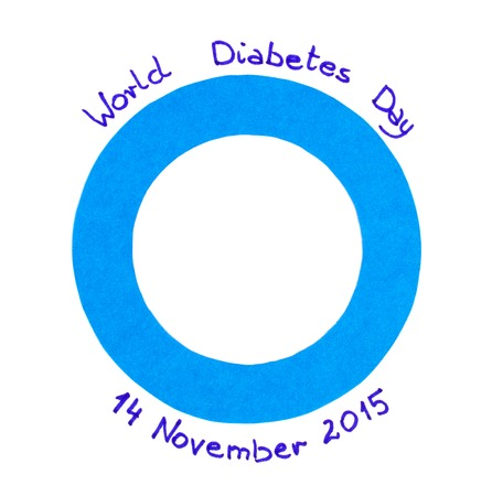 written date: Blue circle of paper and date written on white background, symbol of world diabetes day Stock Photo