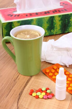 runny: Pills and nose drops for colds, handkerchiefs and hot tea with lemon, treatment of colds, flu and runny Stock Photo