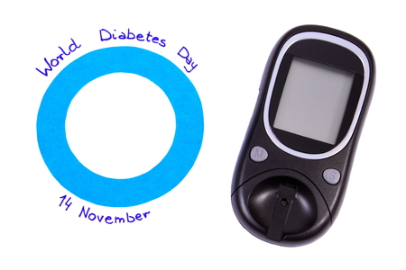 medical fight: Blue circle of paper and date written on white background and glucose meter, symbol of world diabetes day Stock Photo