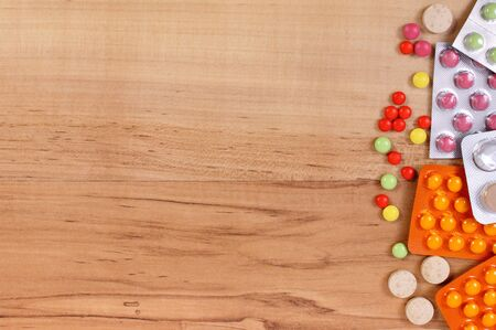 wooden background: Medication for treatment of colds, flu and runny on wooden background