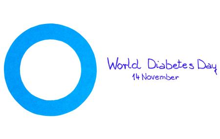 diabetes: C�rculo azul de papel y la fecha escrita en el fondo blanco, s�mbolo del d�a Mundial de la Diabetes Foto de archivo