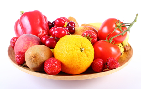 immunity: Fresh ripe fruits and vegetables lying on wooden plate, concept of healthy food, nutrition and strengthening immunity. Isolated on white background