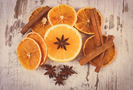 rustic food: Vintage photo, Slices of dried and portion of fresh orange with spices for cooking or baking on old rustic wooden background, healthy food