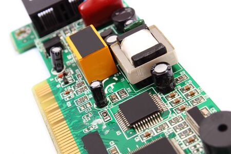 microelectronics: Printed circuit board with electrical components lying on white background, technology