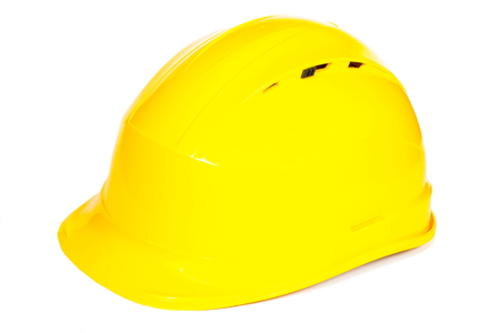 engineering tools: Closeup of yellow protective helmet on white background, concept of security and protection at work