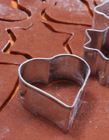 cookie cutters: Cookie cutters in shape of heart and star, dough for Christmas cookies and gingerbread, concept of baking and christmas time