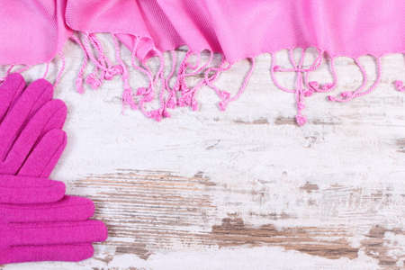 womanly: Frame of woolen gloves and shawl with copy space for text, womanly accessories, warm clothing for autumn or winter, old rustic wooden background Stock Photo