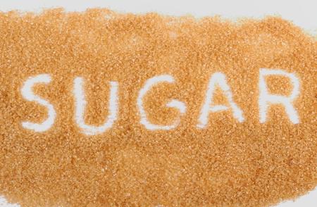 brown sugar: Word sugar written in granulated natural brown cane sugar