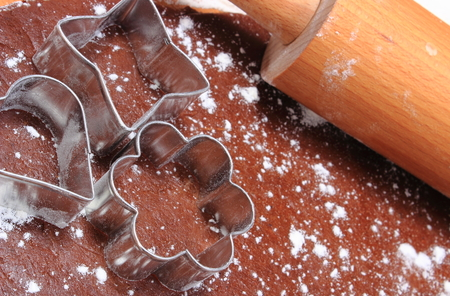 cookie cutters: Cookie cutters and rolling pin lying on dough for cookies, concept for baking Stock Photo