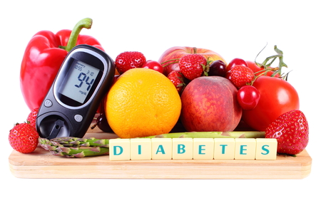 inmunidad: Glucose meter with fresh ripe fruits and vegetables on wooden cutting board, concept of diabetes, healthy food, nutrition and strengthening immunity Foto de archivo