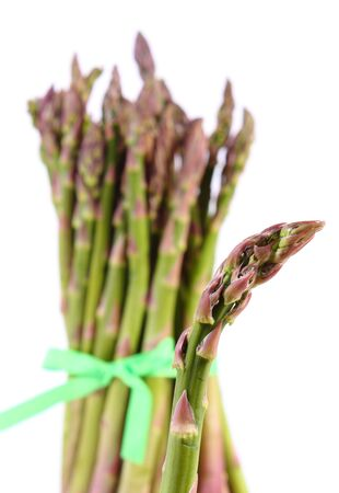 immunity: Bunch of fresh green asparagus on white background, healthy food, nutrition and strengthening immunity. White background Stock Photo