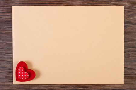 envelope decoration: Valentine red heart and love letter in envelope on wooden background, decoration for Valentines Day, symbol of love, copy space for text