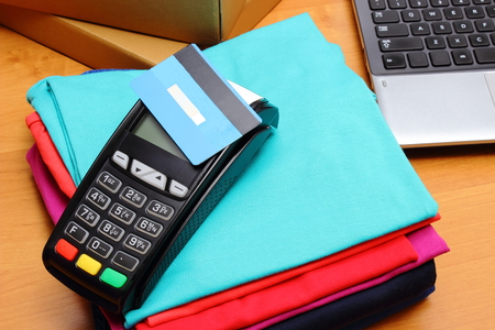 personal identification number: Use payment terminal with contactless credit card with NFC technology for paying for purchases in store, enter personal identification number, credit card reader, finance concept Stock Photo