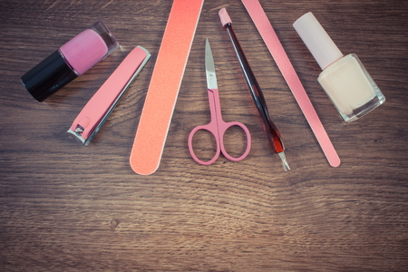 clippers: Vintage photo, Cosmetics and accessories for manicure or pedicure, nail file, nail polish, scissors, nail clippers, concept of nail care Stock Photo