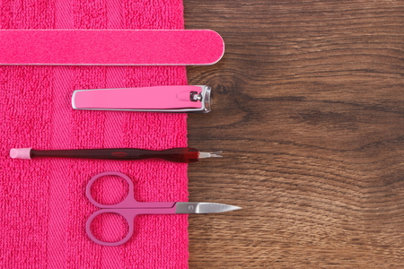 clippers: Accessories for manicure or pedicure, nail file, scissors, nail clippers, fluffy towel, concept of nail care, copy space for text