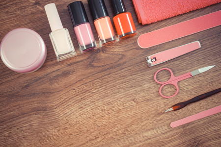 remover: Vintage photo, Cosmetics and accessories for manicure or pedicure, nail file, nail polish and remover, scissors, nail clippers, fluffy towel, concept of nail care, copy space for text Stock Photo