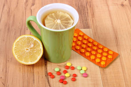 runny: Pills and hot tea with lemon for colds, treatment of colds, flu and runny