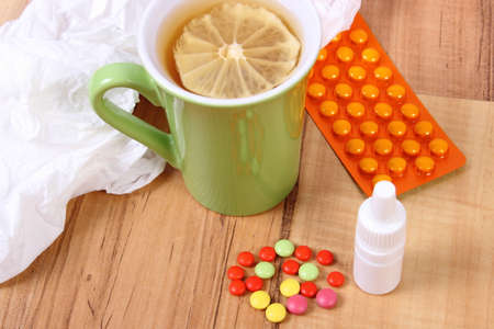 nose drops: Pills and nose drops for colds, handkerchiefs and hot tea with lemon, treatment of colds, flu and runny Stock Photo