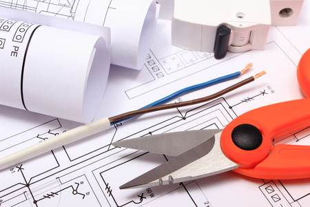 cable cutter: Cable cutter, electric wire and fuse, rolls of electrical diagrams lying on construction drawing of house, accessories for engineer jobs