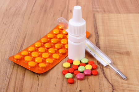 nose drops: Pills, thermometer and nose drops for colds, treatment of colds, flu and runny Stock Photo