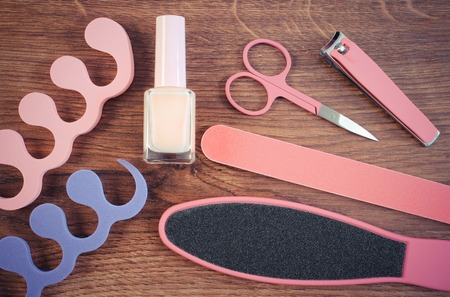 nail file: Vintage photo, Cosmetics and accessories for manicure or pedicure, nail file, scraper, nail polish, scissors, nail clippers, pedicure separators, concept of nail, hand and foot care Stock Photo