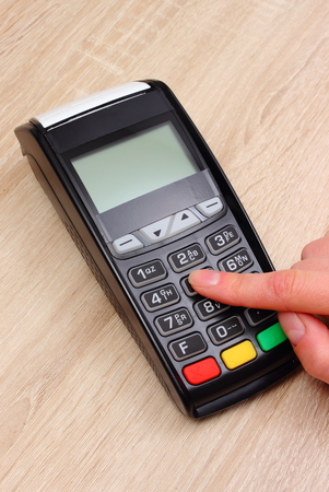 personal identification number: Hand of woman using payment terminal, enter personal identification number, credit card reader, finance and banking concept