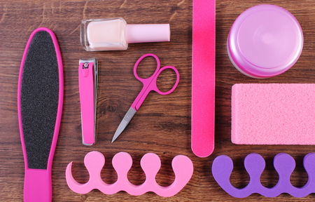 separators: Cosmetics and accessories for manicure or pedicure, nail file, scraper, pumice, nail polish and remover, scissors, nail clippers, pedicure separators, concept of nail, hand and foot care Stock Photo