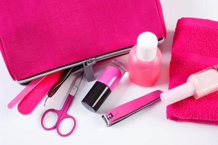 nail file: Cosmetics and accessories for manicure or pedicure, pink bag cosmetic, nail file, nail polish and remover, scissors, nail clippers, fluffy towel, concept of nail care Stock Photo