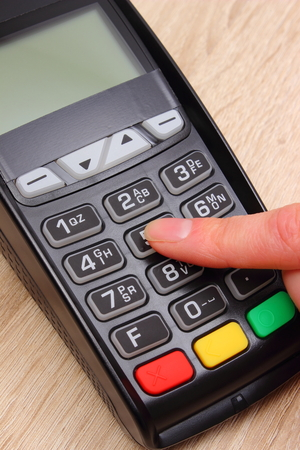 personal banking: Hand of woman using payment terminal, enter personal identification number, credit card reader, finance and banking concept
