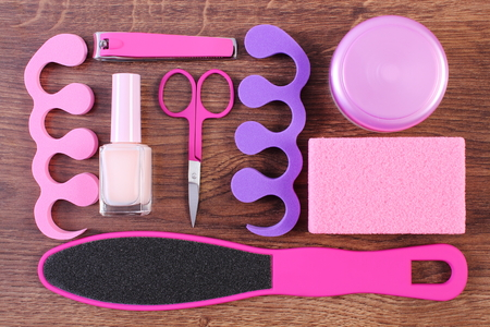 separators: Cosmetics and accessories for manicure or pedicure, scraper, pumice, nail polish and remover, scissors, nail clippers, pedicure separators, concept of nail, hand and foot care