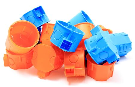 Heap Of Blue And Orange Plastic Electrical Boxes On White Background ...