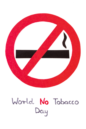 interdiction: Red no smoking sign made of paper with inscription world no tobacco day, symbol of prohibited smoking, healthy lifestyle without cigarettes