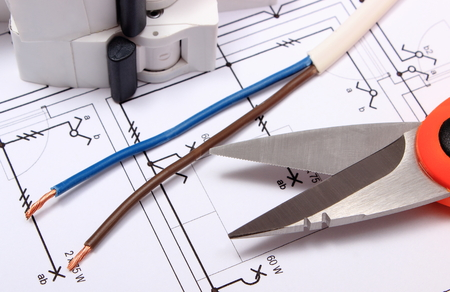 cable cutter: Cable cutter, electric wire and fuse lying on construction drawing of house, accessories for engineer jobs Stock Photo
