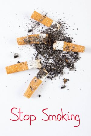 abstain: Cigarette butts and ash with inscription stop smoking, concept of healthy lifestyles without cigarettes, world no tobacco day