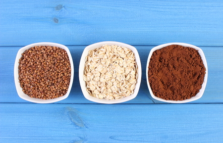 powdery: Natural buckwheat, oatmeal and powdery cocoa containing magnesium and dietary fiber, healthy food and nutrition Stock Photo